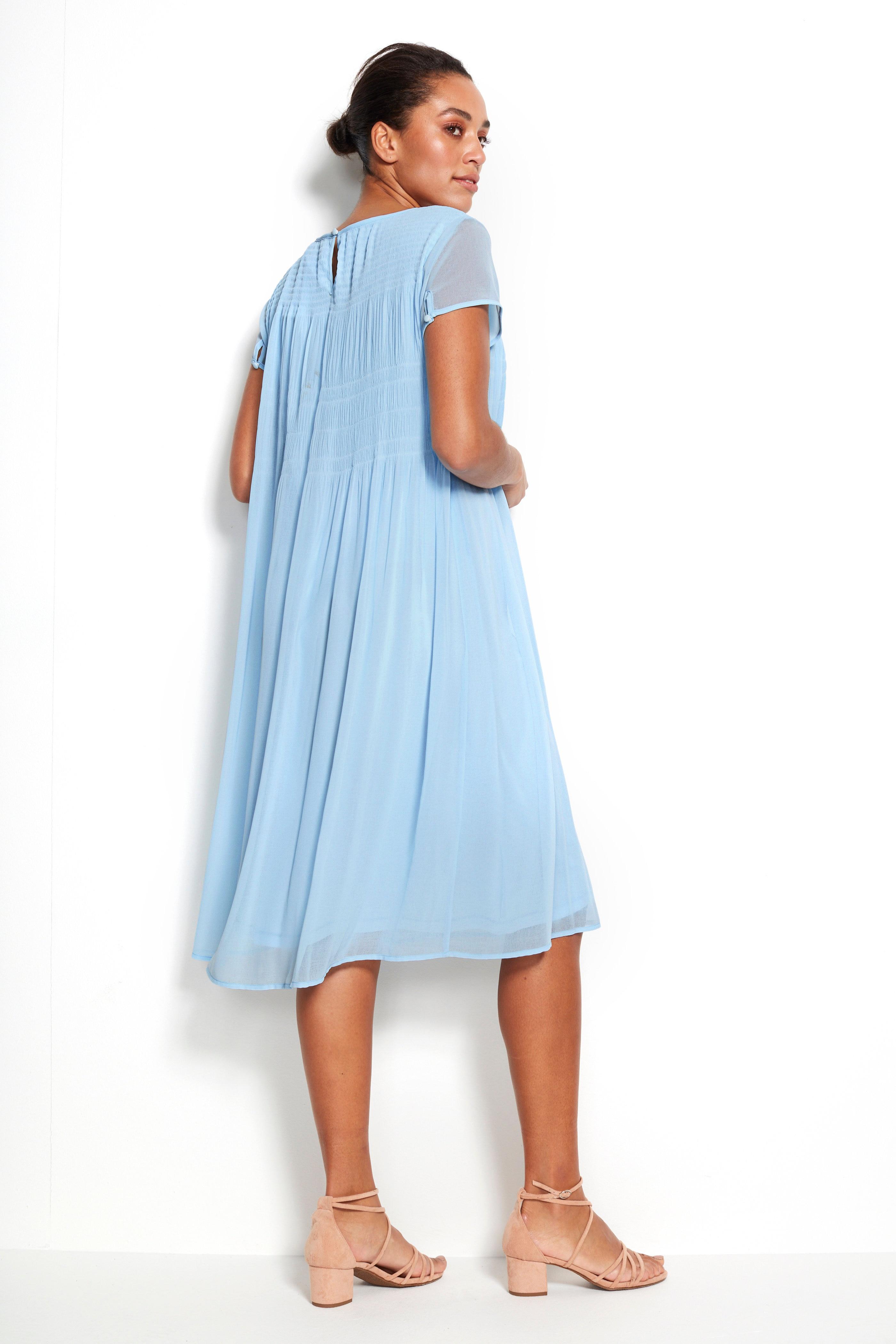 Klänning med plissering